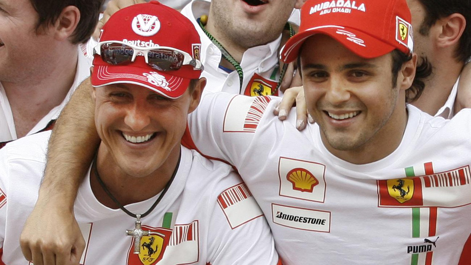 Brazilian Ferrari Formula One driver Felipe Massa, right, hugs former Ferrari star and seven times world champion Michael Schumacher, left, after winning the Spanish Grand Prix at the Montmelo racetrack near Barcelona, Spain, Sunday, May 13, 2007. Schumacher now works as a Ferrari motorsport consultant. (AP Photo/Daniel Ochoa de Olza)