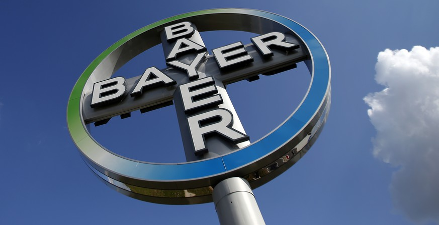 FILE - The Oct. 2, 2013 file photo shows the logo of Bayer at the Berlin Brandenburg Airport in Schoenefeld, Germany.  German drug and chemicals firm Bayer says it has increased its offer for U.S. seed company Monsanto Co. to US$125 per share from its initial bid of US$122 per share. Bayer AG said Thursday July 14, 2016  that the revised all-cash offer follows several weeks of private talks with Monsanto. (AP Photo/Michael Sohn, File)