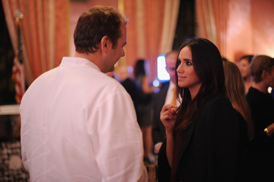 NEW YORK, NY - OCTOBER 01: Meghan Markle (R) and chef Daniel Humm attend RELAIS & CHATEAUX 60th Anniversary Guest Chef Dinner Launch at Consulate General of France on October 1, 2014 in New York City.  (Photo by Bryan Bedder/Getty Images for Relais & Chateaux)