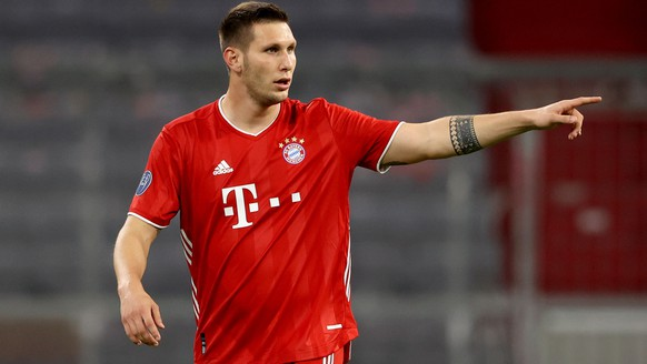 epa08763619 Niklas Sule of Bayern Munich in action during the UEFA Champions League Group A stage match between FC Bayern Munich and Atletico Madrid at Allianz Arena in Munich, Germany, 21 October 2020.  EPA/Alexander Hassenstein / POOL