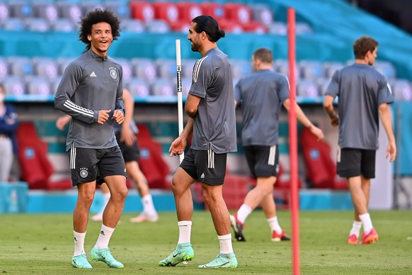 epa09271253 Germany?s Leroy Sane (L) and Emre Can (C) during the German national soccer team's training session in Munich, Germany, 14 June 2021. Germany will face France in their UEFA EURO 2020 group F preliminary round soccer match on 15 June 2021.  EPA/LUKAS BARTH-TUTTAS