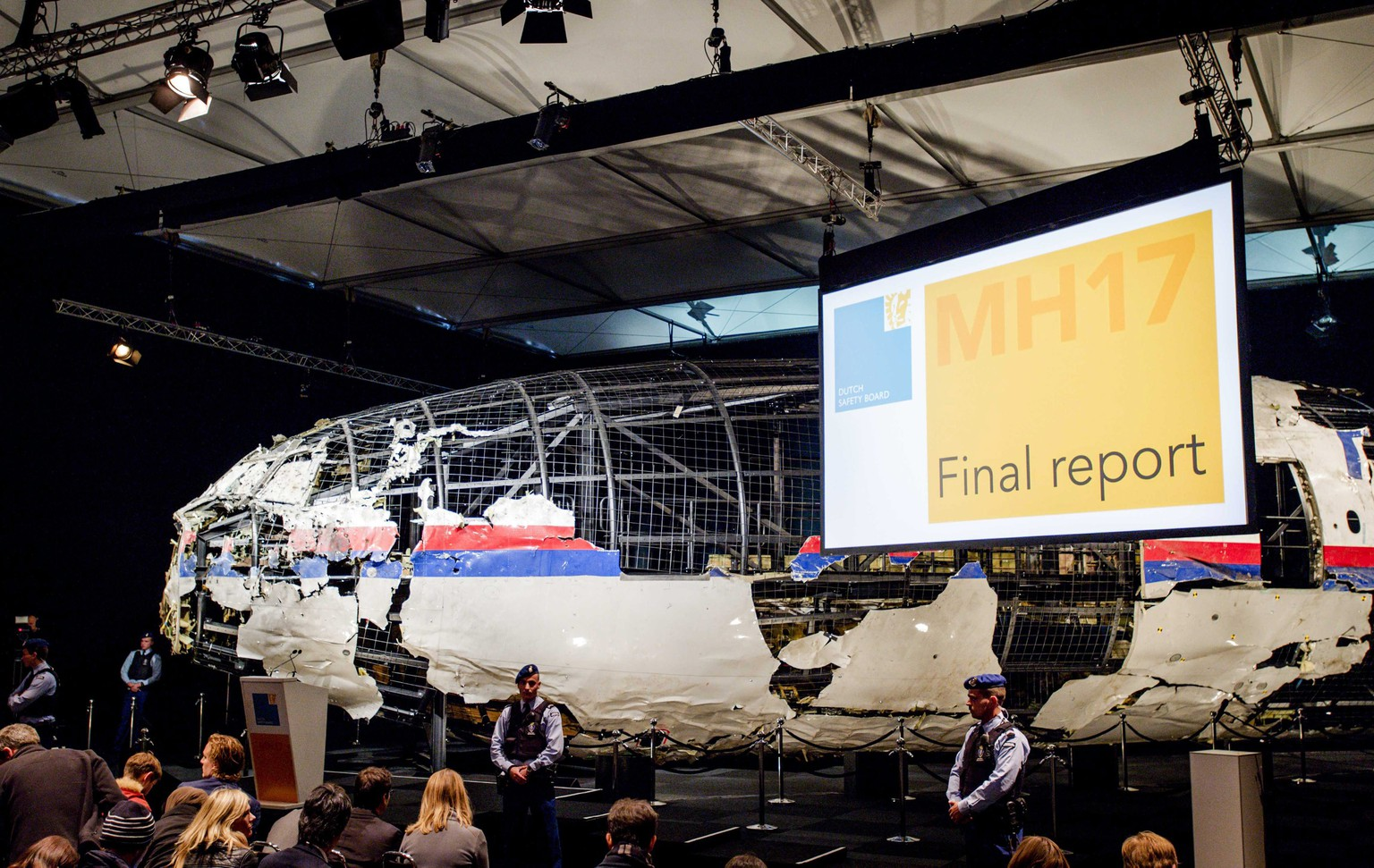 epa04975938 The rebuilt fuselage of Malaysia Airlines flight MH17 during a press conference to present the report findings of the Dutch Safety Board in Gilze Rijen, The Netherlands, 13 October 2015. The Dutch Safety Board was to present its final report into the downing of Malaysia Airlines flight MH17 over eastern Ukraine last year. MH17 was on its way from Amsterdam to Kuala Lumpur when it went down in rebel-controlled territory on 17 July 2014, killing all 298 people on board.  EPA/ROBIN VAN LONKHUIJSEN