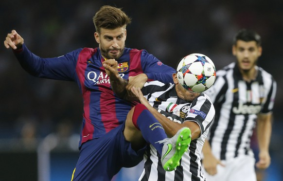 FILE - On this Saturday June 6, 2015 file photo Barcelona's Gerard Pique, left, challenges Juventus' Carlos Tevez for the ball during the Champions League final soccer match between Juventus Turin and FC Barcelona at the Olympic stadium in Berlin. (AP Photo/Frank Augstein, FILE)