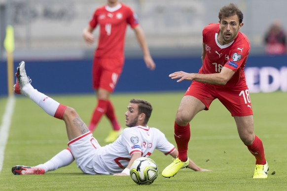 Gibraltar's midfielder Ethan Britto, left, fights for the ball with Switzerland's forward Admir Mehmedi, right, during the UEFA Euro 2020 qualifying Group D soccer match between the Switzerland and Gibraltar, at the Tourbillon Stadium in Sion, Switzerland, Sunday, September 8, 2019. (KEYSTONE/Laurent Gillieron)