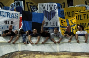 Inter Milan's supporters hold a banner before the start of their Italian Serie A soccer match against Napoli at San Siro stadium in Milan April 26, 2014. REUTERS/Alessandro Garofalo (ITALY - Tags: SPORT SOCCER)