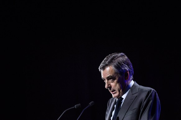 epa05852992 French right-wing party 'Les Republicains'   candidate for the 2017 French presidential elections, Francois Fillon, delivers a speech during an election campaign event in Caen, North Western France, 16 March 2017. His lawyer announced on 14 March 2017 that Francois Fillon was officially charged for several offences including misuse of public funds over the so-called 'fake jobs' scandal.  EPA/CHRISTOPHE PETIT TESSON