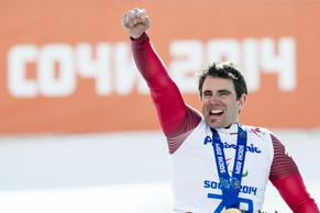 Christoph Kunz of Switzerland celebrate his fist place at the men's giant slalom race at the Winter Paralympics 2014 Sochi in Krasnaya Polyana, Russia, on Saturday, March 15, 2014. (KEYSTONE/Ennio Leanza)