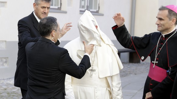 A gust of wind blows Pope Francis' mantle as he arrives to a meeting with people assisted by the church in the Cathedral of Saints Peter and Paul in Tallinn, Estonia, Tuesday, Sept. 25, 2018. Pope Francis concludes his four-day tour of the Baltics visiting Estonia. (AP Photo/Andrew Medichini)