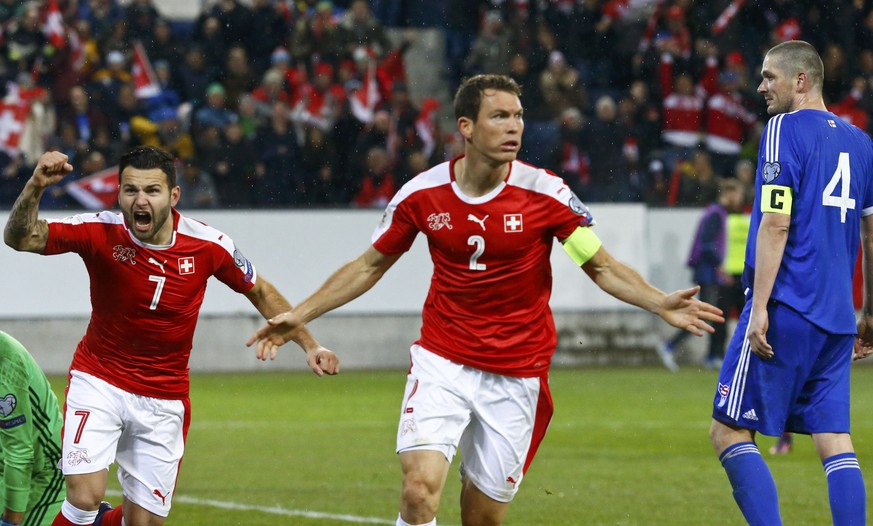 Football Soccer - Switzerland v Faroe Islands - World Cup 2018 Qualifier -  Swissporarena, Luzern, Switzerland - 13/11/16 . Switzerland's Stephan Lichtsteiner and Renato Steffen react REUTERS/Ruben Sprich