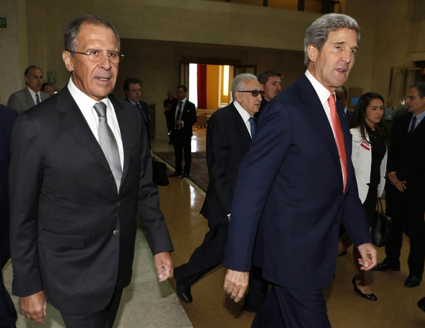 U.S. Secretary of State John Kerry, right, Russian Foreign Minister Sergey Lavrov, left, walk with the U.N.-Arab League envoy for Syria, Lakhdar Brahimi, center, into a meeting at the United Nations offices in Geneva to discuss the ongoing problems in Syria, Friday, Sept. 13, 2013.(AP Photo/Larry Downing, Pool)