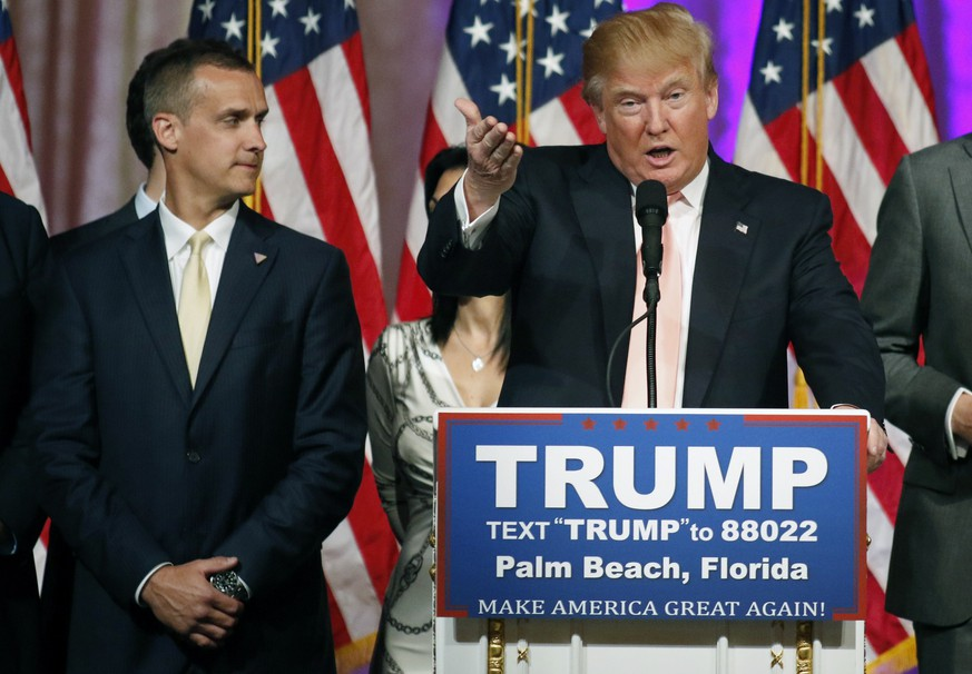 Campaign manager Corey Lewandowski (L) stands next to Republican U.S. presidential candidate Donald Trump  during a news conference in Palm Beach, Florida, in this file photo taken March 15, 2016.  Lewandowski was arrested in Florida on Tuesday and charged with simple battery for intentionally grabbing and bruising the arm of Michelle Fields, police records show.   REUTERS/Joe Skipper/Files