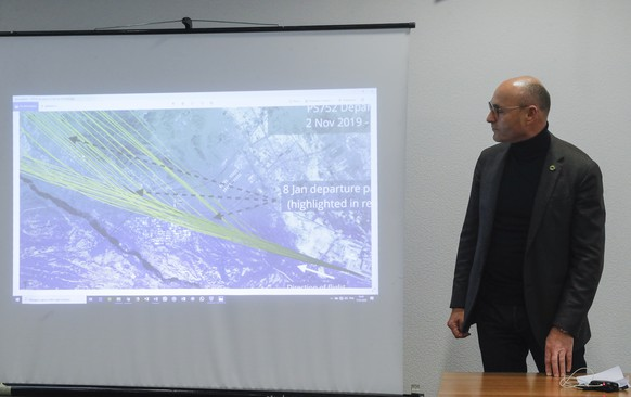 epa08119359 Yevhenii Dykhne, the president of Ukraine International Airlines (UIA) looks at a picture of Flightradar program during a press conference at Boryspil International Airport in Kiev, Ukraine, 11 January 2020. According to media reports on 11 January 2020, the Iranian military released a statement claiming that Ukraine International Airlines flight PS752 was shot down due to 'human error.' The Ukrainian jet, flying from Tehran, Iran, to Kyiv, Ukraine, crashed minutes after takeoff on 08 January 2020, killing all 167 passengers and nine crew members aboard.  EPA/SERGEY DOLZHENKO