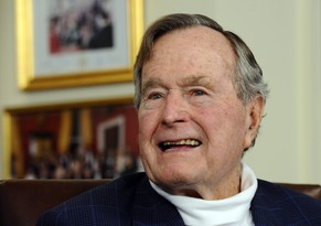 epa04539137 (FILE) Former US President George H.W. Bush in his office in Houston, Texas, USA, 29 March 2012. Former US President George Bush senior was taken to hospital with breathing difficulties, his spokesman said late 23 December 2014. Bush, 90, was taken to a clinic in Houston, Texas, as a precautionary measure, where he would be kept under observation, he said. Republican George HW Bush was president from 1989 to 1993. His son George W was in office from 2001 to 2009.  EPA/LARRY W. SMITH