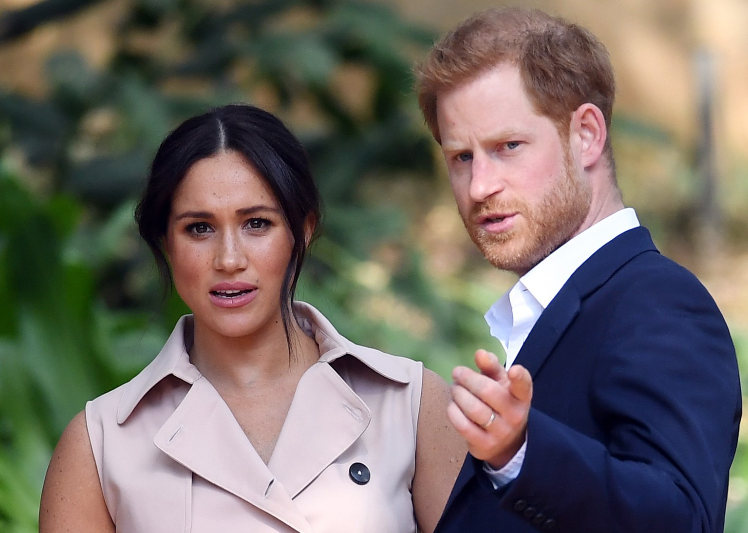 epa07889137 Britain's Prince Harry (R), the Duke of Sussex, and his wife Meghan (L), the Duchess of Sussex, attend a creative industries and business reception at the High Commissioner's residence in Johannesburg, South Africa, 02 October 2019. The Duke and Duchess of Sussex are on an official visit to South Africa that concludes later the same day.  EPA/FACUNDO ARRIZABALAGA