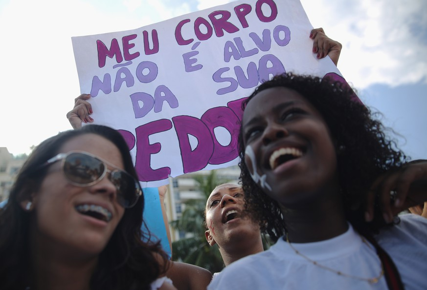 RIO DE JANEIRO, BRAZIL - MARCH 08:  Women chant during a march marking International Women's Day on March 8, 2015 in Rio de Janeiro, Brazil. Marches and events were held worldwide to support gender equality and women who battle gender-based violence.  (Photo by Mario Tama/Getty Images)