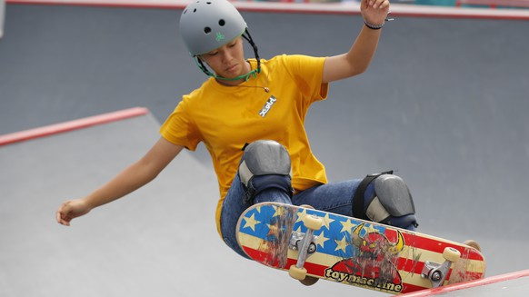 Japan's Kaya Isa competes in the women's skateboard park final at the 18th Asian Games in Palembang, Indonesia, Wednesday, Aug. 29, 2018. (AP Photo/Vincent Thian)