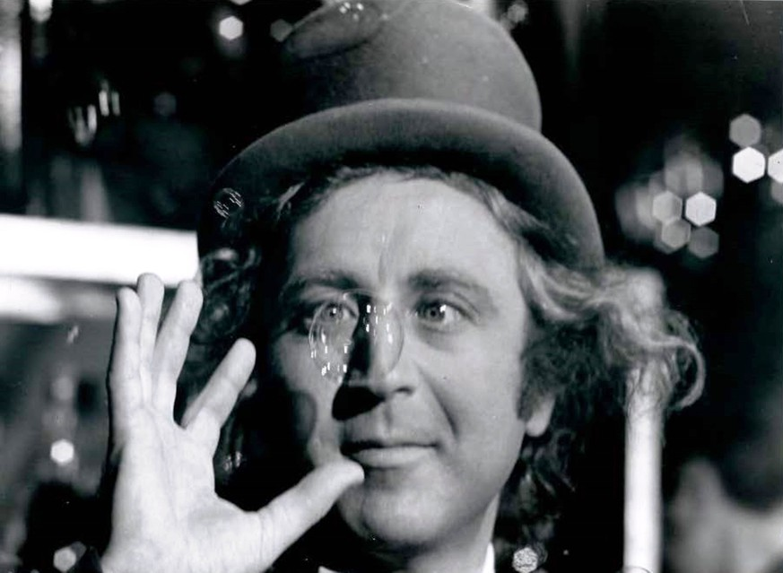 This handout photo provided by Warner Bros. and the Library of Congress shows Gene Wilder as the mercurial Willy Wonka amused by one of his creations. Courtesy Warner Bros.