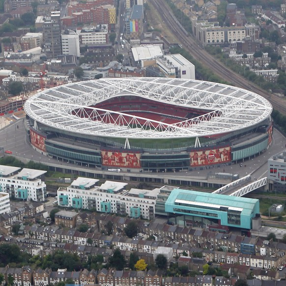 LONDON, ENGLAND - JULY 26:  An aerial view of The Emirates Stadium home of Arsenal Football Club with their former home Highbury in the foreground on July 26, 2011 in London, England.  (Photo by Tom Shaw/Getty Images)