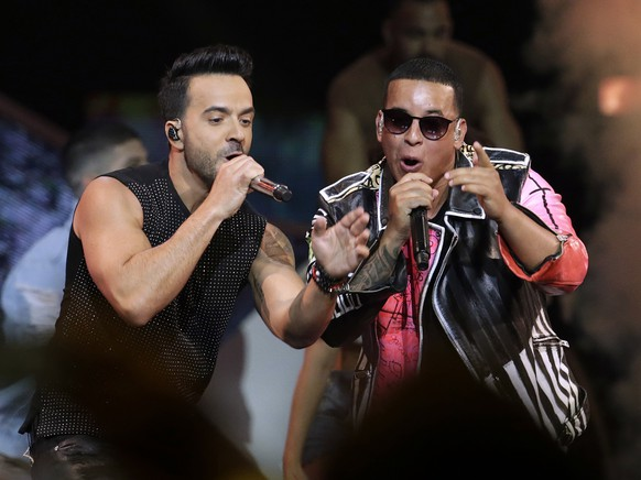"FILE - This April 27, 2017, file photo shows singers Luis Fonsi, left, and Daddy Yankee during the Latin Billboard Awards in Coral Gables, Fla. ""Despacito'""s hit-makers Luis Fonsi and Daddy Yankee received 5 Latin American Music Awards nominations. (AP Photo/Lynne Sladky, File)"