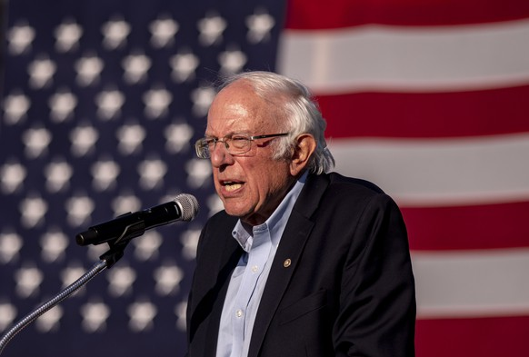 Sen. Bernie Sanders speaks to the crowd at a car rally campaign event for Democratic presidential candidate former Vice President Joe Biden on Monday, Oct. 5, 2020, in Warren, Mich. (Nicole Hester/Ann Arbor News via AP)