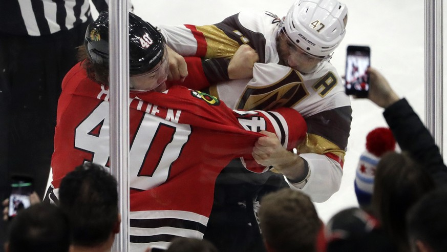 Chicago Blackhawks right wing John Hayden, left, and Vegas Golden Knights defenseman Luca Sbisa fight during the second period of an NHL hockey game Friday, Jan. 5, 2018, in Chicago. (AP Photo/Nam Y. Huh)