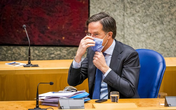epa09094273 Outgoing Prime Minister Mark Rutte in the Lower House during a debate about the developments surrounding the corona virus in The Hague, the Netherlands, 24 March 2021.  EPA/LEX VAN LIESHOUT