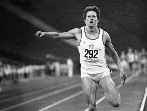 Czechoslovakia's Jarmila Kratochvilova, crosses the finish line to win the women's 800-meters event in new world record time of 1 minute and 53.28 seconds during the International track and field meeting at the Olympic Stadium in Munich, Germany on Tuesday, July 26, 1983. (AP Photo/Uwe Lein)