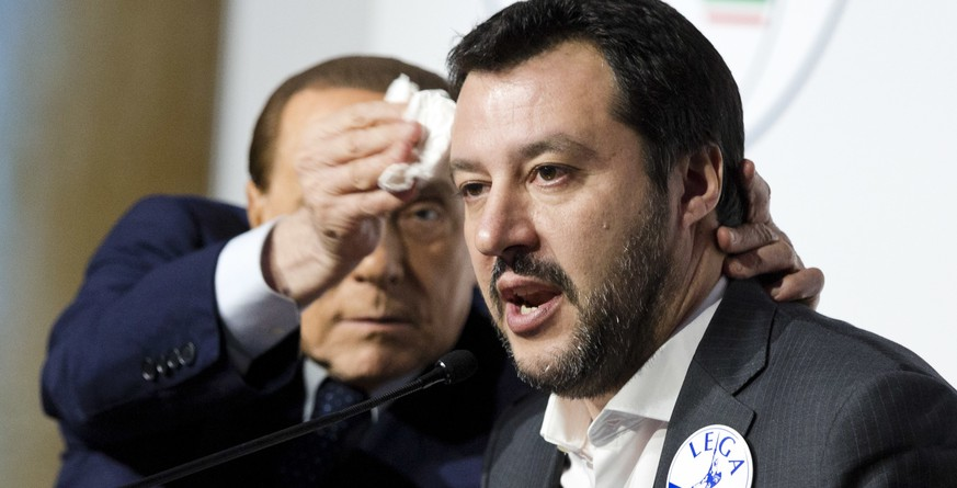 Forza Italia's Silvio Berlusconi, left, wipes the forehead of The League's Matteo Salvini at a media event for center-right leaders ahead of the March 4 general elections, in Rome, Thursday, March 1, 2018. (AP Photo//Domenico Stinellis)