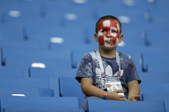 A Croatia fan sits on the stands prior to the start of the group D match between Iceland and Croatia, at the 2018 soccer World Cup in the Rostov Arena in Rostov-on-Don, Russia, Tuesday, June 26, 2018. (AP Photo/Natacha Pisarenko)