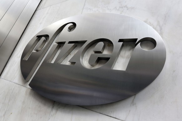 File- This Dec. 4, 2017, photo shows the Pfizer company logo at the company's headquarters in New York.  The federal government has agreed to pay nearly $2 billion for 100 million doses of a potential COVID-19 vaccine being developed by the U.S. drugmaker and its German partner BioNTech.  (AP Photo/Richard Drew, File) Pfizer