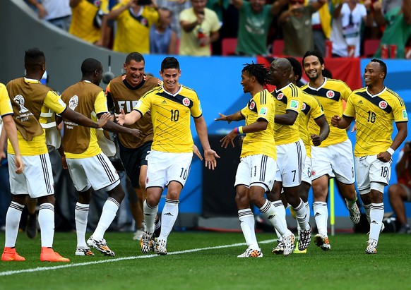 BRASILIA, BRAZIL - JUNE 19:  James Rodriguez #10 of Colombia celebrates by dancing with teammates after scoring his team's first goal during the 2014 FIFA World Cup Brazil Group C match between Colombia and Cote D'Ivoire at Estadio Nacional on June 19, 2014 in Brasilia, Brazil.  (Photo by Christopher Lee/Getty Images)
