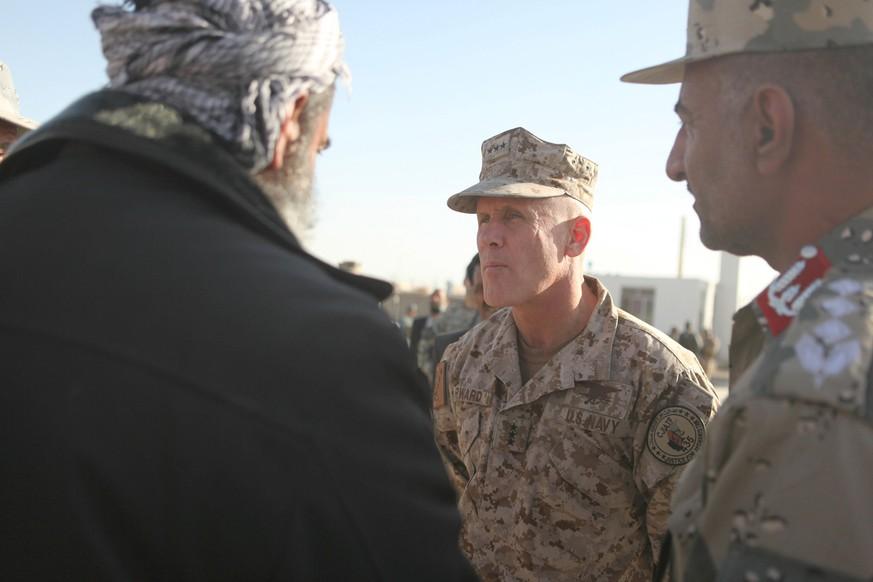 Vice Admiral Robert S. Harward, commanding officer of Combined Joint Interagency Task Force 435, greets an Afghan official during his visit to Zaranj, Afghanistan, January 6, 2011. Picture taken January 6, 2011.  Photo courtesy of Sgt. Shawn Coolman/Department of Defense/Handout via REUTERS   ATTENTION EDITORS - THIS IMAGE WAS PROVIDED BY A THIRD PARTY. EDITORIAL USE ONLY.