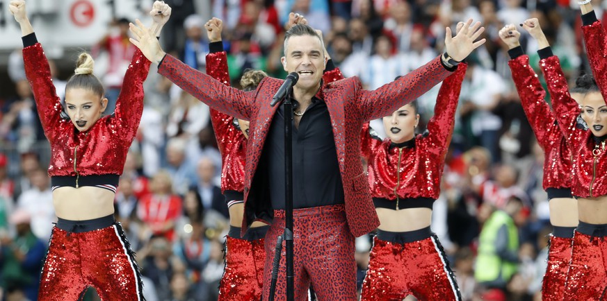 British singer Robbie Williams sings at the opening of the World Cup 2018 ahead of the start of the group A match between Russia and Saudi Arabia which opens the 2018 soccer World Cup at the Luzhniki stadium in Moscow, Russia, Thursday, June 14, 2018. (AP Photo/Antonio Calanni)