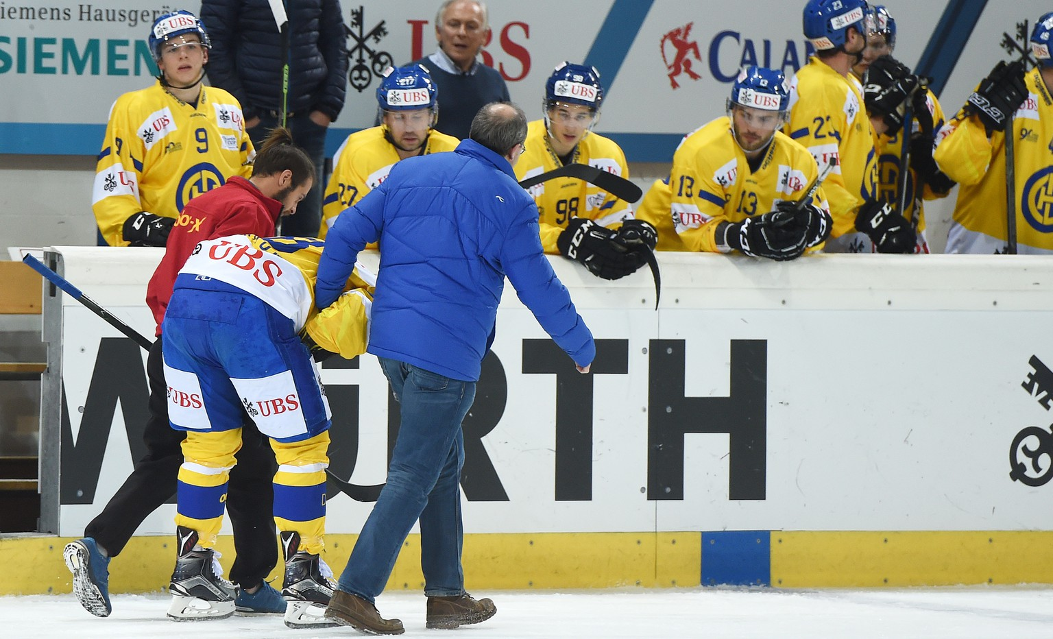 Davos Gregory Sciaroni goes out after a check during the game between Switzerlands HC Lugano and Switzerlands HC Davos at the 90th Spengler Cup ice hockey tournament in Davos, Switzerland, Friday, December 30, 2016. (KEYSTONE/Melanie Duchene)