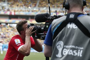 Switzerland's Xherdan Shaqiri kisses the tv camera after scoring he 1-0 during the group E preliminary round match between Switzerland and Honduras in the Arena da Amazonia in Manaus, Brazil, Wednesday, June 25, 2014. (KEYSTONE/Peter Klaunzer)