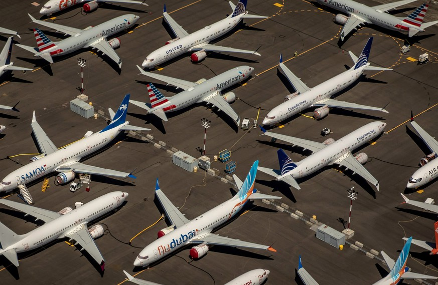 epa08175494 (FILE) - An aerial view of Boeing 737 Max 8 aircraft parked at Boeing Field in Seattle, Washington, USA, 21 July 2019 (reissued 29 January 2020). Boeing on 29 January 2020 published their full year and 4th quarter 2019 results saying they suffered 636 million USD losses, its first full-year loss since 1997. Boeing also said they expect the costs related to the crisis of grounding their new 737 Max passenger planes to continue to climb.  EPA/GARY HE   EDITORIAL USE ONLY *** Local Caption *** 55353867