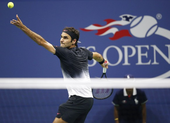 Roger Federer, of Switzerland, serves in the third set of a quarterfinal match against Juan Martin del Potro, of Argentina, at the U.S. Open tennis tournament in New York, Wednesday, Sept. 6, 2017. (AP Photo/Kathy Willens)