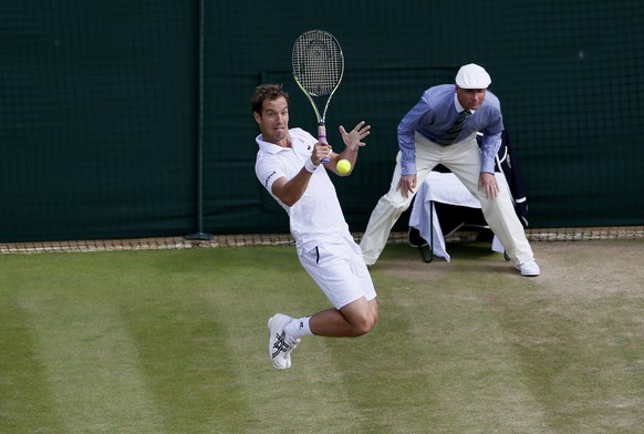 Richard Gasquet of France hits a shot during his match against Stan Wawrinka of Switzerland at the Wimbledon Tennis Championships in London, July 8, 2015.                             REUTERS/Stefan Wermuth