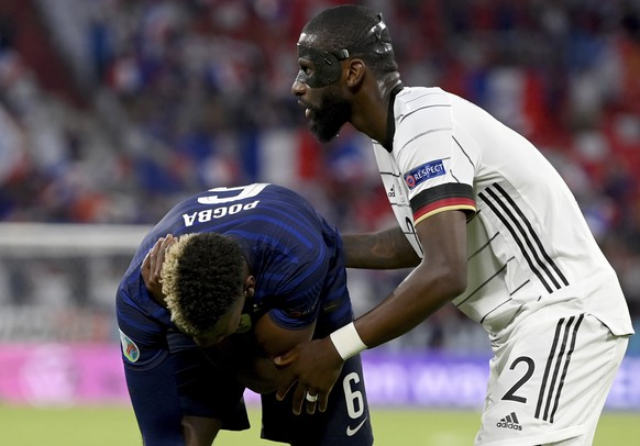 Germany's Antonio Ruediger, right, stands beside France's Paul Pogba during the Euro 2020 soccer championship group F match between France and Germany at the Allianz Arena stadium in Munich, Tuesday, June 15, 2021. (Matthias Hangst/Pool via AP)