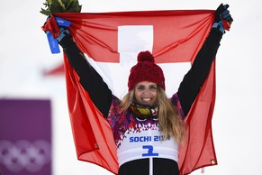 Switzerland's winner Patrizia Kummer celebrates on podium after the women's snowboard parallel giant slalom finals at the 2014 Sochi Winter Olympic Games in Rosa Khutor February 19, 2014.          REUTERS/Dylan Martinez (RUSSIA  - Tags: OLYMPICS SPORT SNOWBOARDING)