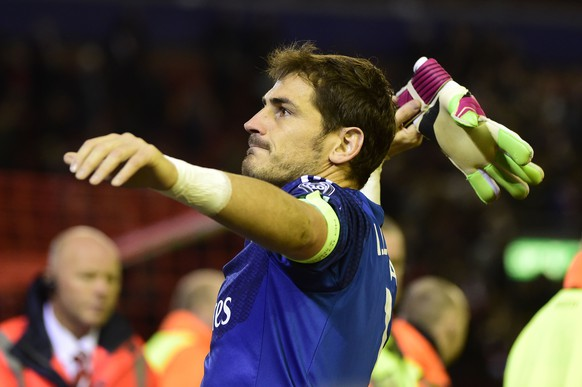Real Madrid's Spanish goalkeeper Iker Casillas throws a glove after the final whistle in the UEFA Champions League, group B, football match between Liverpool and Real Madrid at Anfield in Liverpool, northwest England, on October 22, 2014. AFP PHOTO / PIERRE-PHILIPPE MARCOU
