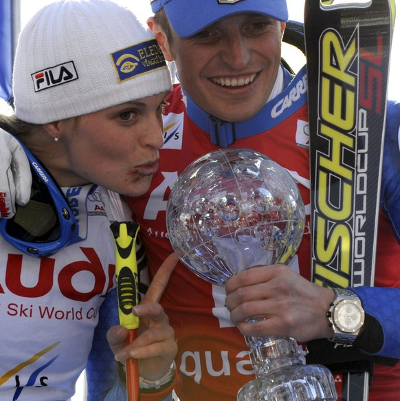 Italy's Manfred Moelgg, right, holds the trophy of the men's slalom title as her sister Manuela, who finished second in a women's giant slalom stands beside him, at the alpine ski, World Cup finals, in Bormio, Italy, Saturday, March 15, 2008. (AP Photo/Armando Trovati)