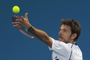 Stanislas Wawrinka of Switzerland serves to Rafael Nadal of Spain during their match for the third place at the Mubadala World Tennis Championship in Abu Dhabi January 3, 2015. 