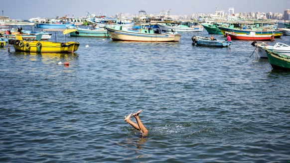 epa06201845 A boy swims in the sea, in Alexandria, Egypt, 08 September 2017 (Issued 13 September 2017). Alexandria is Egypt's second largest city and is located by the Mediterranean coast. The city is famous for its public beaches, the huge range of cheap and expensive hotels, and cheap rental apartments, which made the city an affordable destination for internal tourism. With the schools starting in Egypt on 16 September 2017, families flood the city to spend the last days of the summer vacation.  EPA/MOHAMED HOSSAM ATTENTION: This Image is part of a PHOTO SET