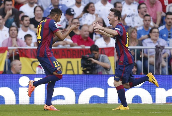 "Barcelona's Neymar (L) celebrates with Lionel Messi after scoring against Real Madrid during their Spanish first division ""Clasico"" soccer match at the Santiago Bernabeu stadium in Madrid October 25, 2014.      REUTERS/Juan Medina (SPAIN  - Tags: SOCCER SPORT)"