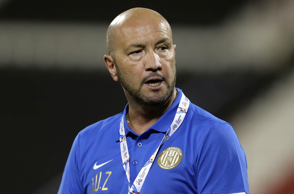 Al-Jazira UAE head coach Walter Zenga of Italy reacts during their AFC Championship League soccer match against Qatar Al-Rayyan in Doha April 16, 2014.REUTERS/Fadi Al-Assaad (QATAR - Tags: SPORT SOCCER)