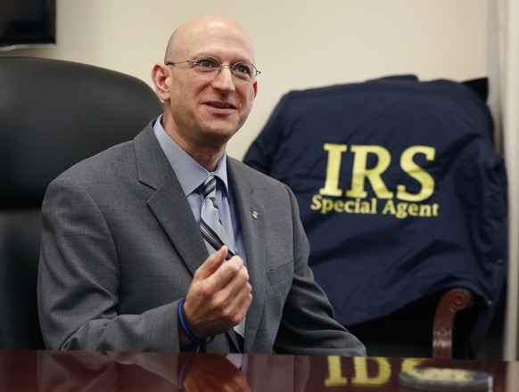 The Internal Revenue Service's Criminal Investigative Division Chief Richard Weber speaks inside his office in Washington, August 14, 2014. Budget pressures at the division are cutting the number of investigators there to the lowest level in four decades, and officials say the changes are forcing the division to scale back its fight of financial crime. Weber in an interview said his goal is to get the number of special agents back up to at least 3,000. Picture taken August 14, 2014. To match IRS-ENFORCEMENT/BUDGET    REUTERS/Larry Downing   (UNITED STATES - Tags: POLITICS CRIME LAW BUSINESS)