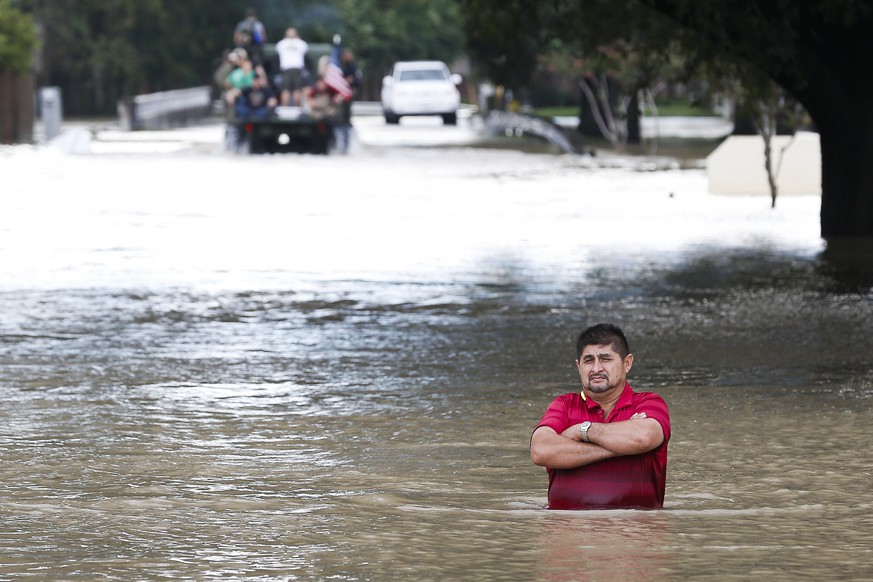 A man stands in deep flood water along West Little York Road as Addicks Reservoir surpasses capacity due to near constant rain from Tropical Storm Harvey Tuesday, Aug. 29, 2017 in Houston. ( Michael Ciaglo / Houston Chronicle)/Houston Chronicle via AP)