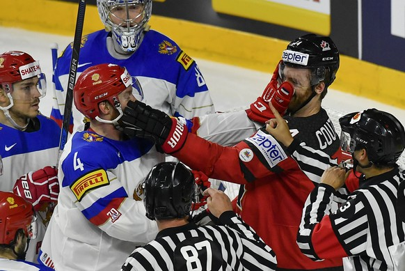 Canada's Sean Couturier, right, fights with Russia's Vladislav Gavrikov during the Ice Hockey World Championships semifinal match between Canada and Russia in the LANXESS arena in Cologne, Germany, Saturday, May 20, 2017. (AP Photo/Martin Meissner)