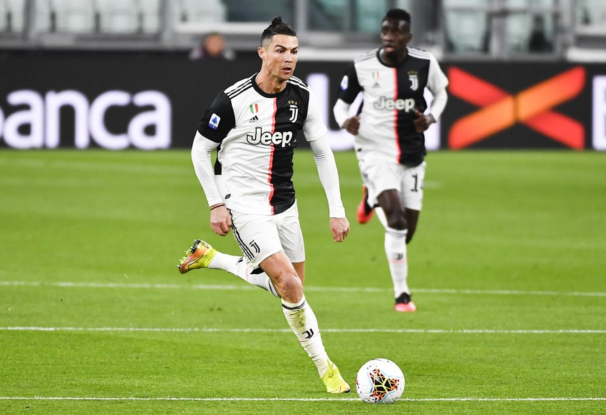 FILE - In this March 8, 2020 file photo, Juventus' Cristiano Ronaldo runs with the ball during the last Serie A soccer match Juventus played before the coronavirus stop, at the Allianz Stadium in Turin, Italy. Cristiano Ronaldo has reported back to Juventus' training center after a 10-week absence. The five-time Ballon d'Or winner showed up for medical tests with the Serie A leader Tuesday, May 19, 2020. Ronaldo observed a two-week isolation period at his home in Turin after spending the lockdown period in his native Portugal. (Marco Alpozzi/LaPresse via AP)